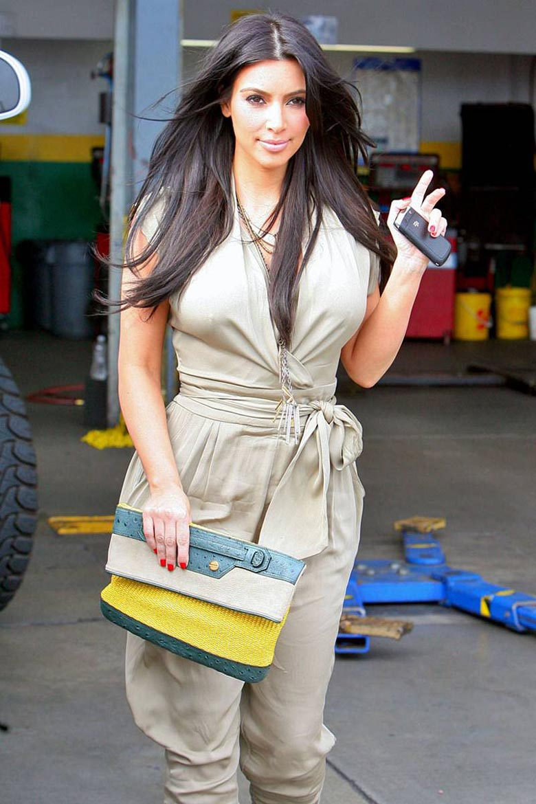 Kim Kardashian - Sexy Legs in Short Leather Dress Out in