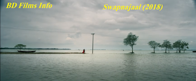 Swapnajaal (2018) is a Bangladeshi dramatic and romantic film, story and screenplay written and directed by Giasuddin Selim. The film is about the set of 1990s suburbs of Bangladesh and West Bengal against the background of communal riots. It is a love story between two young souls.The story of the film is very complex and dramatic. But truly it is a romantic tragic film. The two lovers have to move away but wish to reunite.    Plot Summary  Apu and Shuvra love each other very much. Apu is a son of a Muslim family.His father Rahaman Miah has a business of rice/paddy import export. Shuvra's father Hiran Shaha has an oil factory. Aynal Gazi is a local dominant person of the suburb Chandpur. He tactfully ousts Shuvra's family members after hiding Hiran Shaha. Shuvra's family is compelled to move to Kolkata. Shuvra's mother moves to Kolkata from Chandpur with her son Gopal and daughter Shuvra to her brother in law's house. Thereafter, Aynal Gazi kills Hiran Shaha with his activists and ousts Hiran Shaha's house and oil factory. Thandu, activist of Aynal Gazi marries Julekha and they start to live in Hiran's house. But Aynal Gazi keeps Hiran's oil factory to his right. Apu starts to go to Kolkata to see his lover Shuvra. But unfortunately, he goes to Agartala. He comes back home and can know that Aynal Gazi has killed Hiran Shaha from Julekha. Shuvra gets a job at the Minarva Theater by Biswambhar Babu. Biswambhar Babu is not all that a good person. So, Shuvra tries to avoid him. Aynal Gazi kills Thandu in suspicion that Thandu has killed Apu. But in the next time, he can know that Apu has come back from Agartala. Julekha moves to Faridpur. Apu goes to Kolkata informs Shuvra and her family members. Shuvra wants to come back to Chandpur with Apu for justice of the killer of her father. But her Uncle can know that Shuvra and Apu are so attractive to each others. So, he does not permit to to go with Apu. But Shuvra comes back Chandpur with Apu even leaving theater. They com