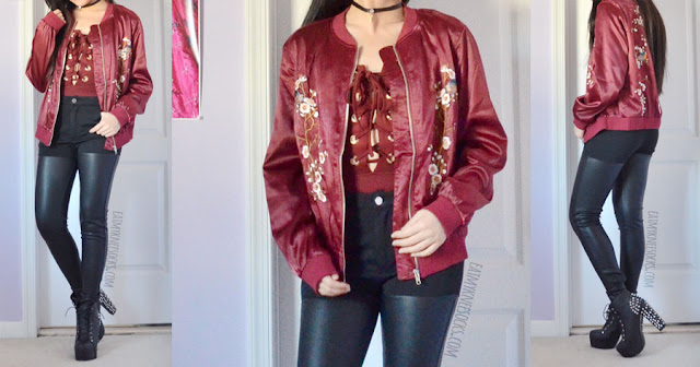 Edgy holiday outfit featuring a maroon lace-up plunging bodysuit and burgundy floral embroidered silky satin bomber jacket from SheIn, paired with high-waisted faux leather paneled skinny jeans and an embellished choker.