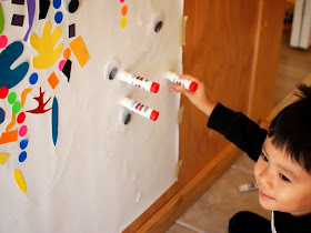 gluing on eyeballs and glue sticks to the wall