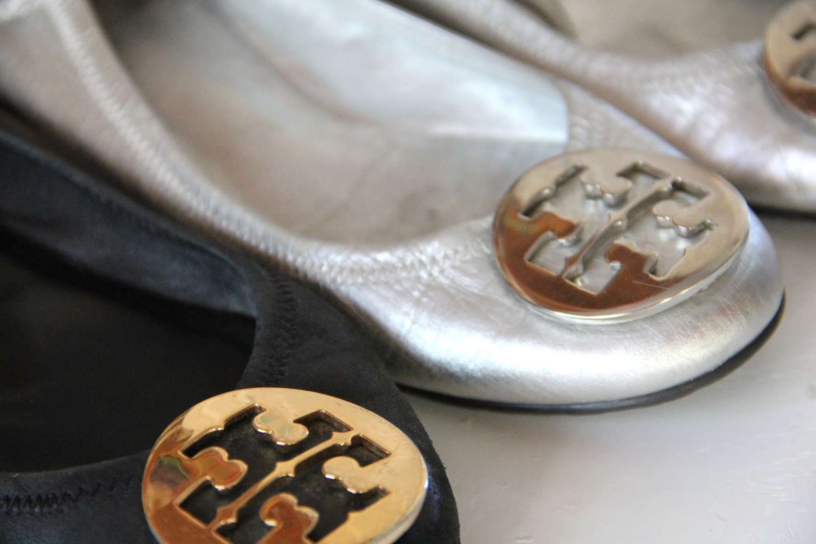 3215acc007ac Buckle- Tory Burch Revas have a monogrammed logo buckle on the toe of the  flat. The logo comes in GOLD and SILVER. No other colors.