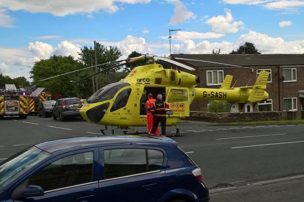 BREAKING UPDATE: Woman, 73, airlifted to hospital after car mounts pavement and carries her through a fence