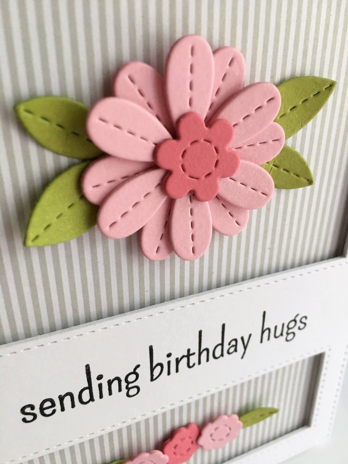 Im in haven happy birthday hugs the flowers and the frame using the tiny flowers on the bottom to mimic the single flower on the top the sentiment is from altenew birthday greetings izmirmasajfo