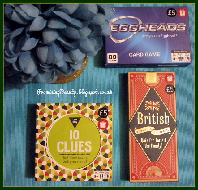 Eggheads and British trivia cards for after christmas dinner games. Teal flower and background.