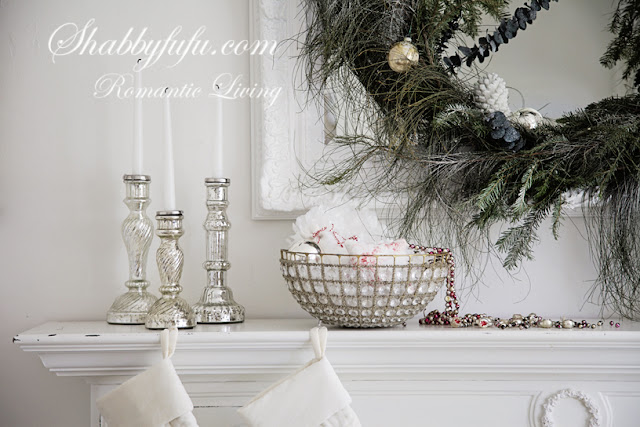 romantic decorating looks for Christmas - romantic mantel display with silver candle sticks and a fern green holiday wreath
