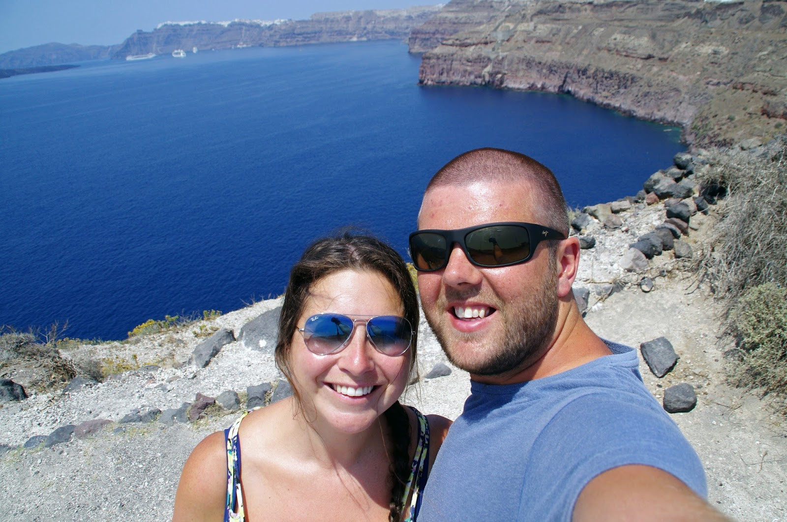 Couple in Santorini overlooking Caldera