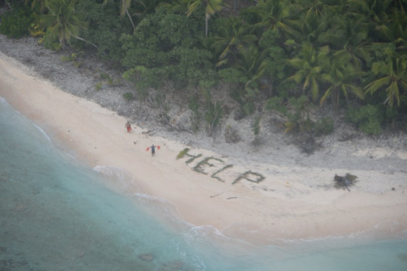 "Three Castaways Rescued from Deserted Island After Writing ""HELP"" on Sand"