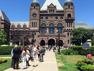Queen's Park with people in front of it