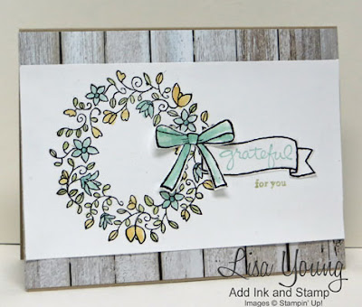 Stampin' Up! Circle of Spring stamp set. Barn wood paper background with blue and yellow wreath. Handmade card by Lisa Young, Add Ink and Stamp