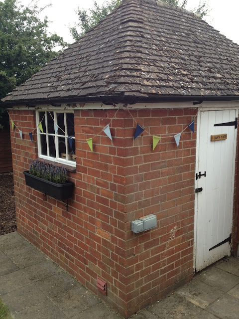 garden shed with bunting