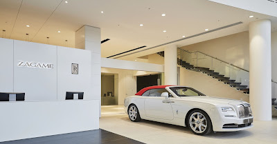 Source: Rolls-Royce Motor Cars. The reception area for the Rolls-Royce showroom in Melbourne with the limited edition commissioned Collection Rolls-Royce Dawn – Inspired by Fashion car finished in Andalusian White and Mugello Red on the right.