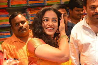 Actress Nithya Menen Pictures in Silk Saree at Kalamandir 25th Store Launch  0021