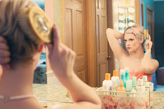 pic of woman looking in mirror
