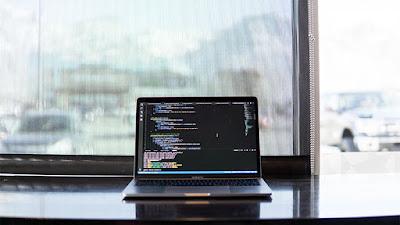 desktop computer with code in screen
