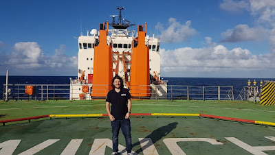 James Williams standing on the front helideck of the ship in the North Atlantic.