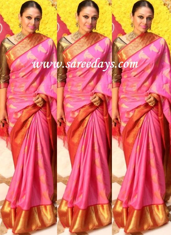 Latest saree designs shobana in pink silk saree checkout shobana in pink silk saree with huge border and zari work all over the saree and paired with contrast long sleeves blouse altavistaventures Images