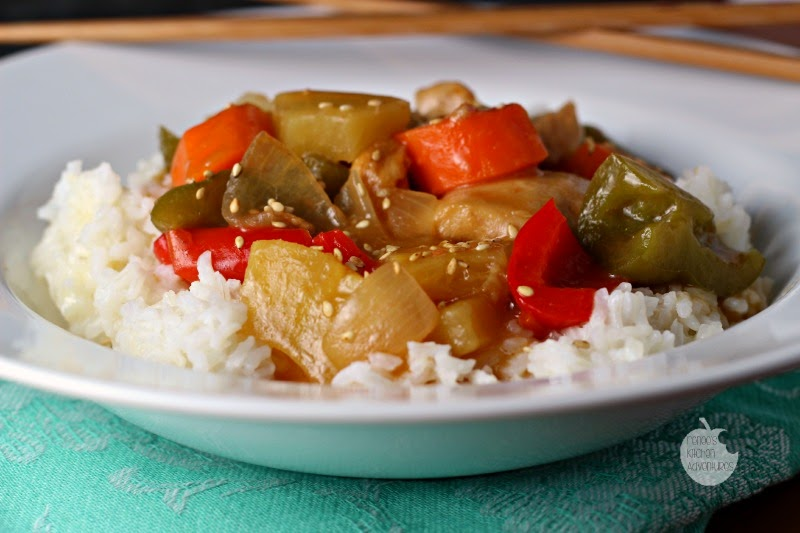 Slow Cooker Sweet and Sour Chicken: Tender chicken thighs and veggies in a delightful sweet and sour sauce!