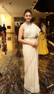 Actress Rakul Preet Singh Stills in White Dress at Winner Pre Release Function  0040.jpg