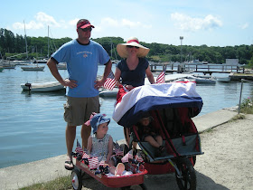 family at boat harbor on July 4th
