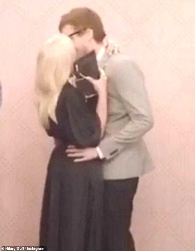 Hilary Duff is seen passionately kissing her beau Matthew Koma in flirty Instagram clip