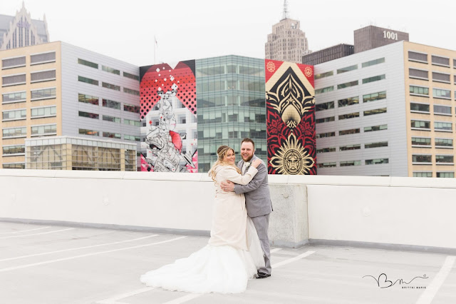 bride and groom overlooking Detroit city skyline on z belt lot