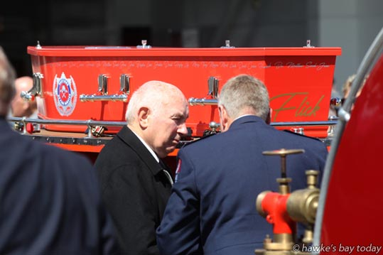 The funeral of Kevin Adie, a firefighter of 34 years and a community worker, at the Hastings Fire Station, Hastings. At the end of the service he was carried away on a vintage trailer pump and Dennis Fire engine for a circuit of the Hawke's Bay Hospital block. photograph