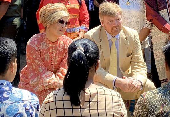 Queen Maxima wore Zimmermann Veneto border paisley print linen dress. Maxima visited a traditional Batak village and Del Institute