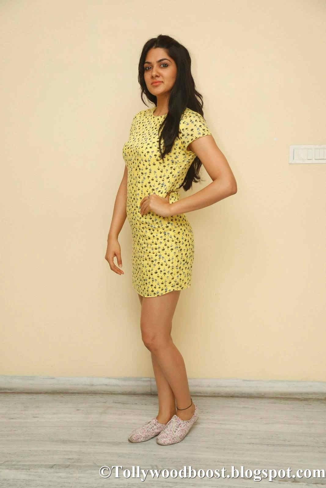 Actress Sakshi Chaudhary Long Legs Show In Yellow Mini Top