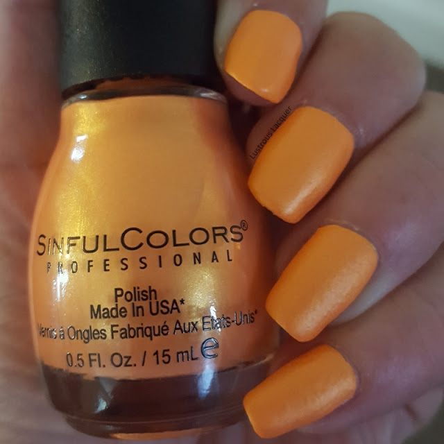 Creamsicle orange neon nail polish with yellow gold shimmer from the Wild at Heat Collection
