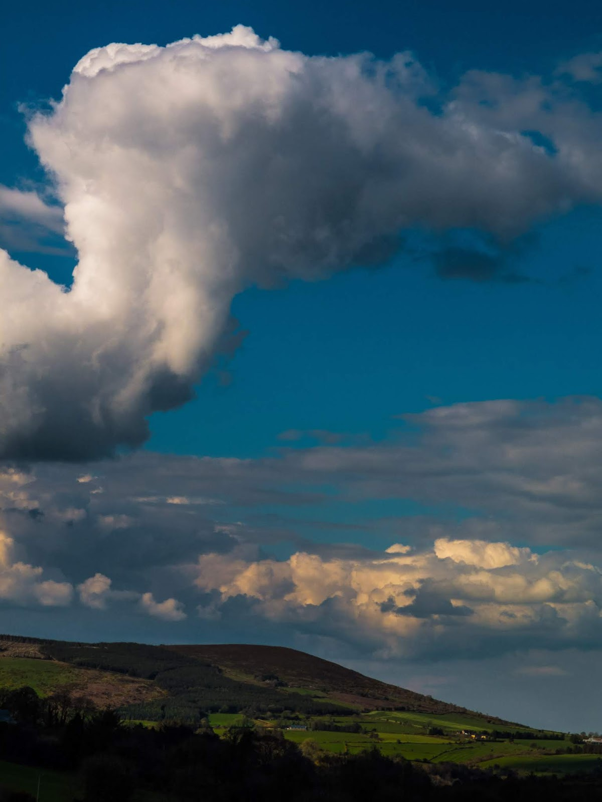 A big cloud hanging over a mountain in North Cork.