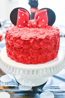 This tutorial will show you exactly how to master those beautiful piped rosettes. The cake can then be turned into a cute character, like Minnie Mouse, with just a few fondant additions.