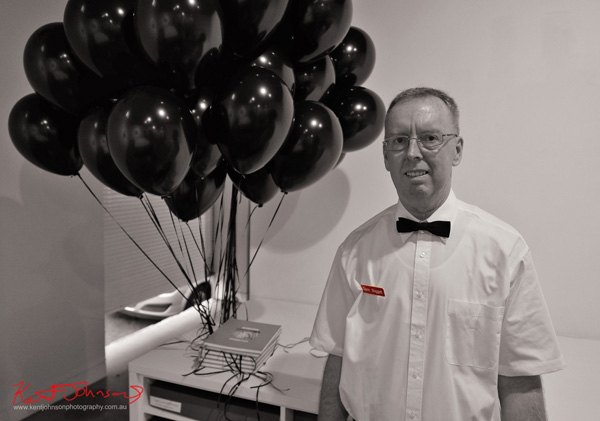 Opening night portrait of Glenn Sloggett with his black balloons he was handing out to select patrons at his show, Down in the dumps, Stills Gallery, Sydney, Australia.