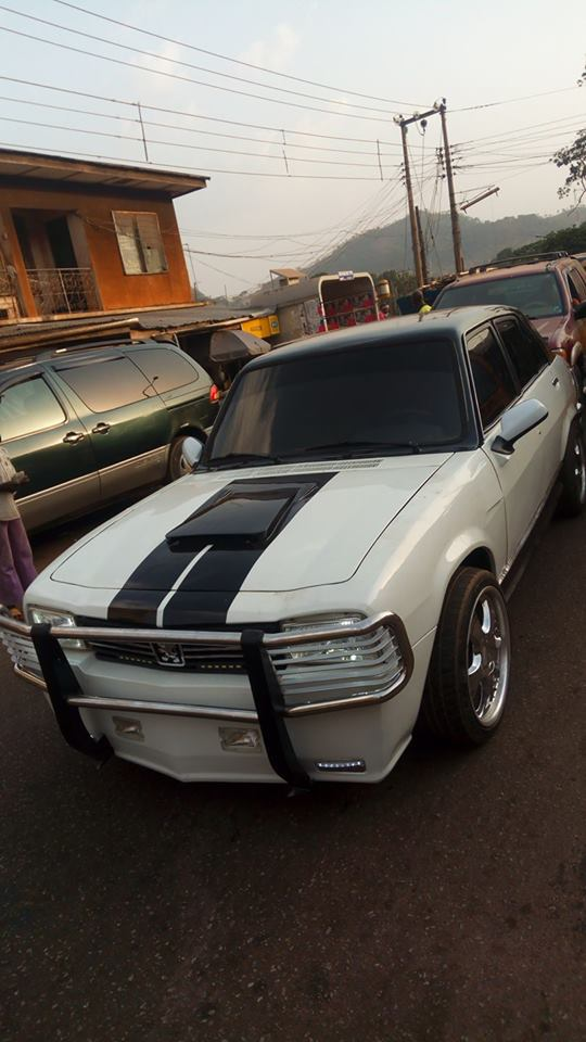 nigerian man transforms old and abandoned 1968 peugeot 504 car into