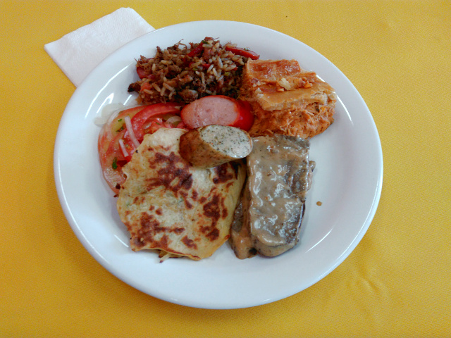 Rice with duck and sausages - a plate with some of the most traditional German food for lunch.