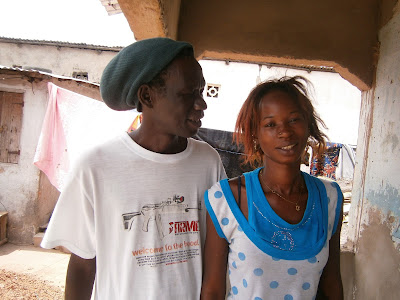 Mame Diarra with her husband at their home in The Gambia.