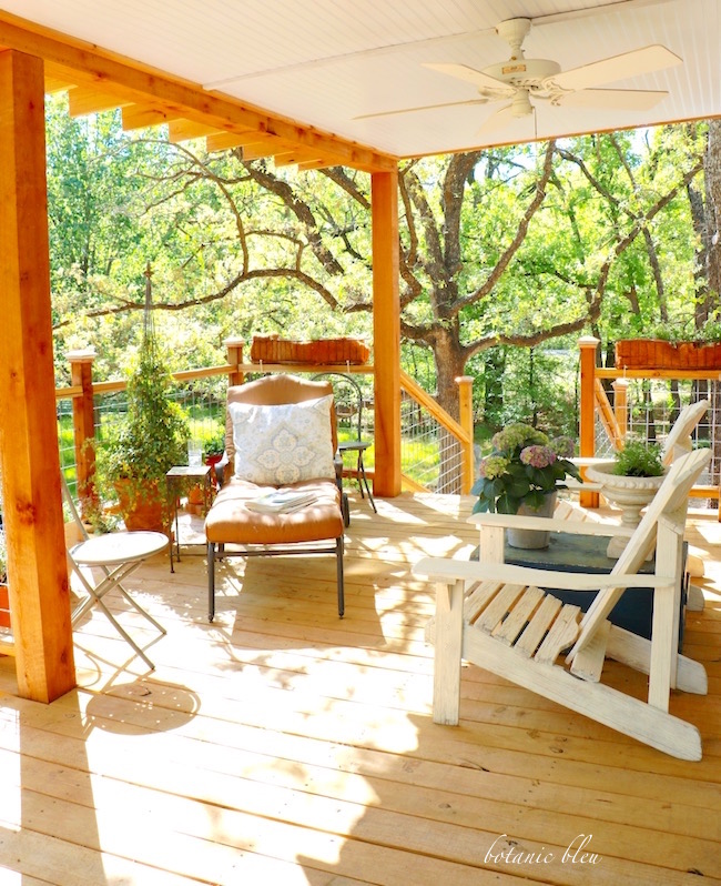 covered-porch-with-chairs-chaise-lounge