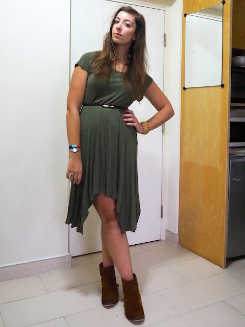 In the Jungle | work outfit of long, loose, forest green dress with belted waist and brown ankle boots