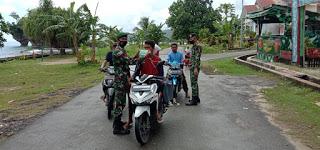 Satgas Yonarmed 9 Kostrad Penertiban dan Sosialisasi Penggunaan Masker di Patani.lelemuku.com.jpg