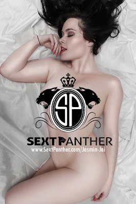Jasmin Jai Laying on white silk sheets with a SextPanther logo laying on top of her nude body