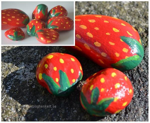 stenar målade som jordgubbar