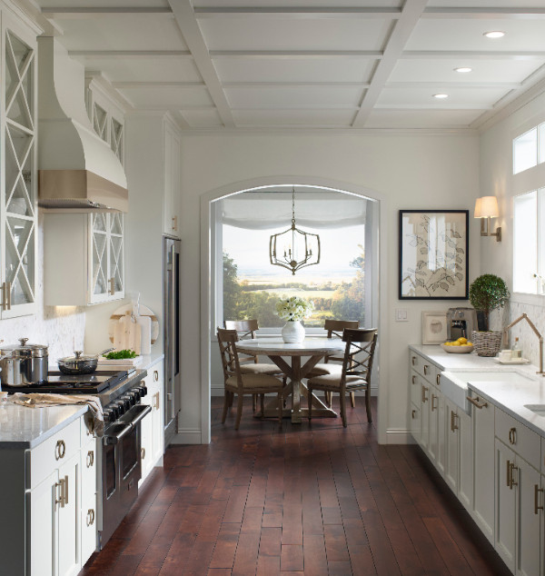 Traditional white kitchen with stainless appliances and charming breakfast area