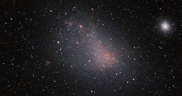 The Small Magellanic Cloud (SMC) galaxy is a striking feature of the southern sky even to the unaided eye. But visible-light telescopes cannot get a really clear view of what is in the galaxy because of obscuring clouds of interstellar dust. VISTA's infrared capabilities have now allowed astronomers to see the myriad of stars in this neighbouring galaxy much more clearly than ever before. The result is this record-breaking image — the biggest infrared image ever taken of the Small Magellanic Cloud — with the whole frame filled with millions of stars.  As well as the SMC itself this very wide-field image reveals many background galaxies and several star clusters, including the very bright 47 Tucanae globular cluster at the right of the picture.  Credit: ESO/VISTA VMC