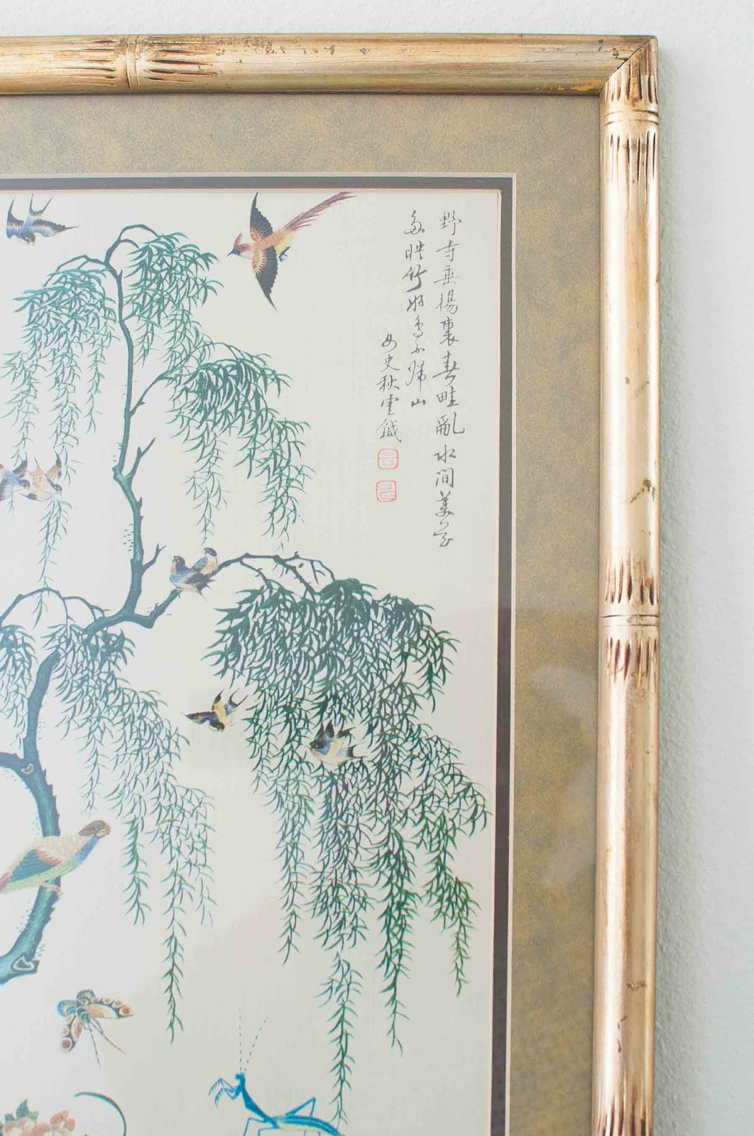 Vintage chinoiserie art in a gilt bamboo frame.