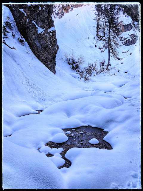 Frozen River in the bottom of Canyon before Doughnut Falls in Big Cottonwood Canyon Salt Lake City Utah
