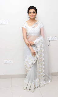 Kajal Aggarwal Sizzles in a White Transparent Saree and Blouse Choli
