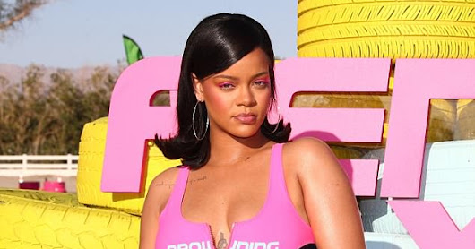 Rihanna in a zipped down swimsuit and baggy pants as she hosts star-studded Fenty x Puma party at Coachella
