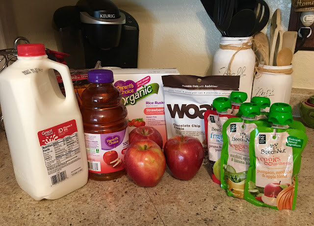 half gallon of milk, apple juice, apples, crackers, woats, veggie and fruit pouches