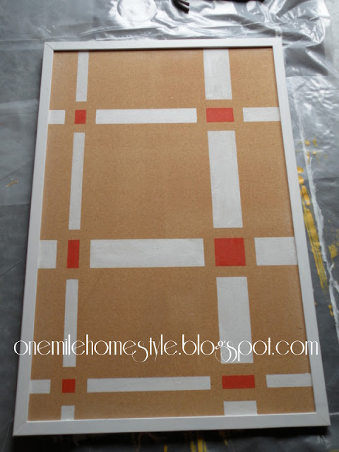 Bulletin board with abstract white and orange design