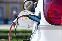 Charge white electric car (Credit: Getty Images) Click to enlarge.