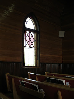 Unity of the body of Christ is crucial - image of light streaming through church window